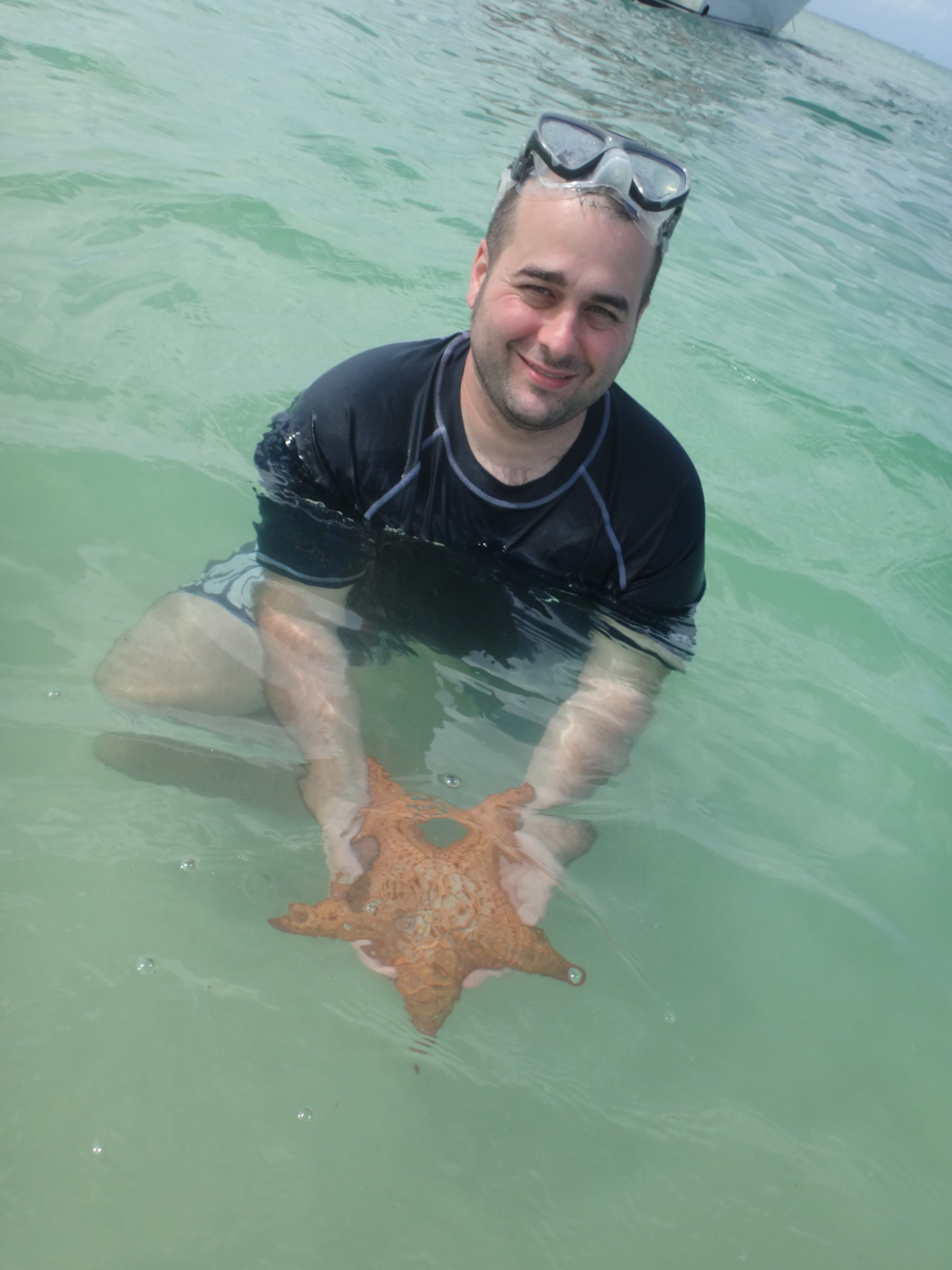 Holding a Starfish at Starfish Point in Grand Cayman