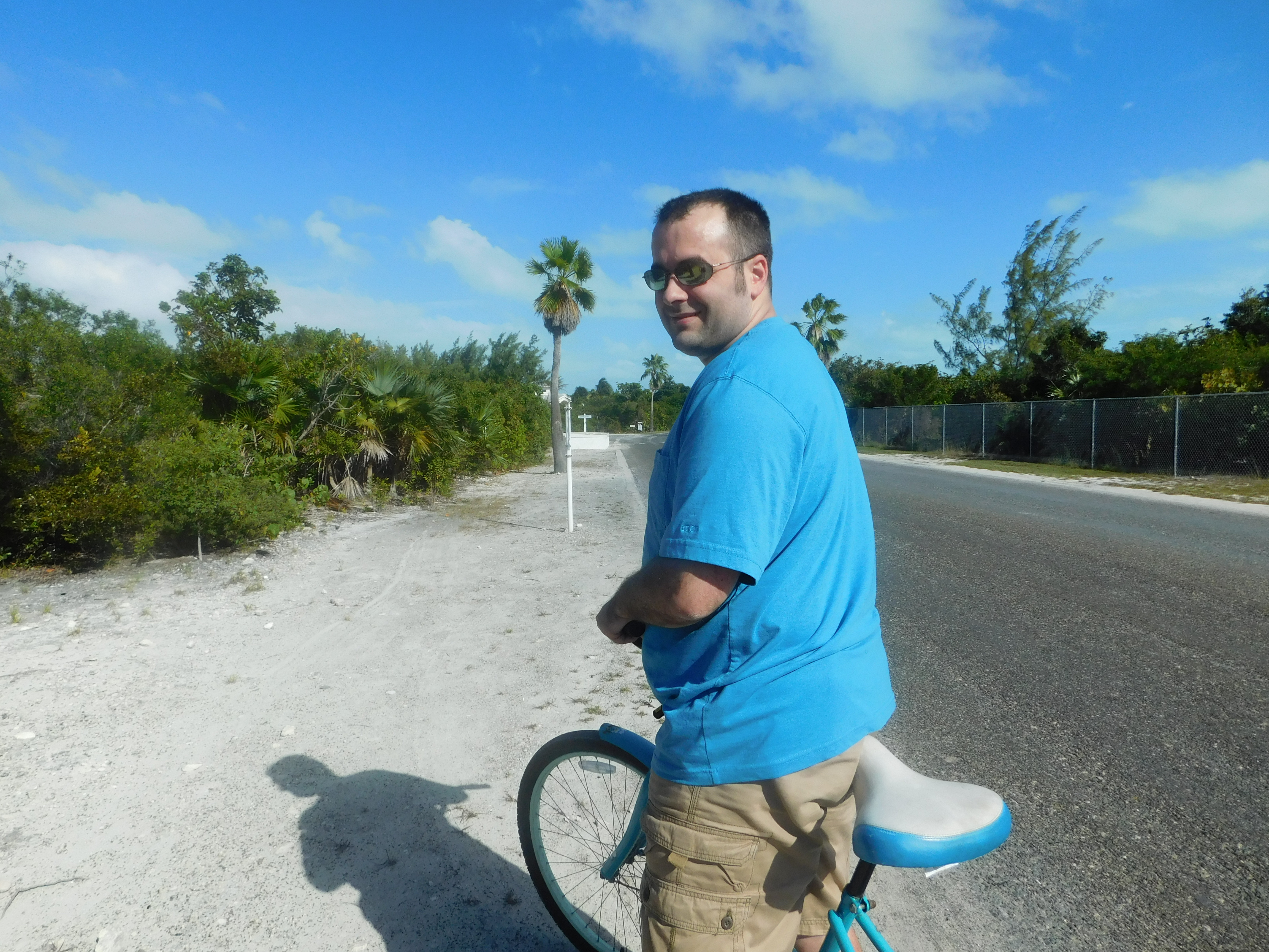 Riding Bicycles near Grace Bay Beach in Turks & Caicos. Island Guide.