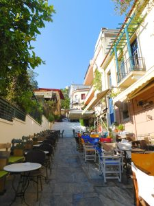 Tables line the street in the Plaka neighborhood in Athens, Greece.
