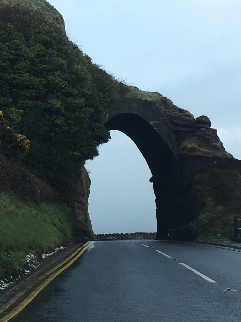 Beautiful natural arch on ourNorthern Ireland roadtrip along the Antrim coast.