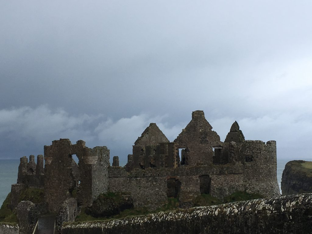 A stormy sky over Dunluce Castle as seen during our roadtrip across Northern Ireland.