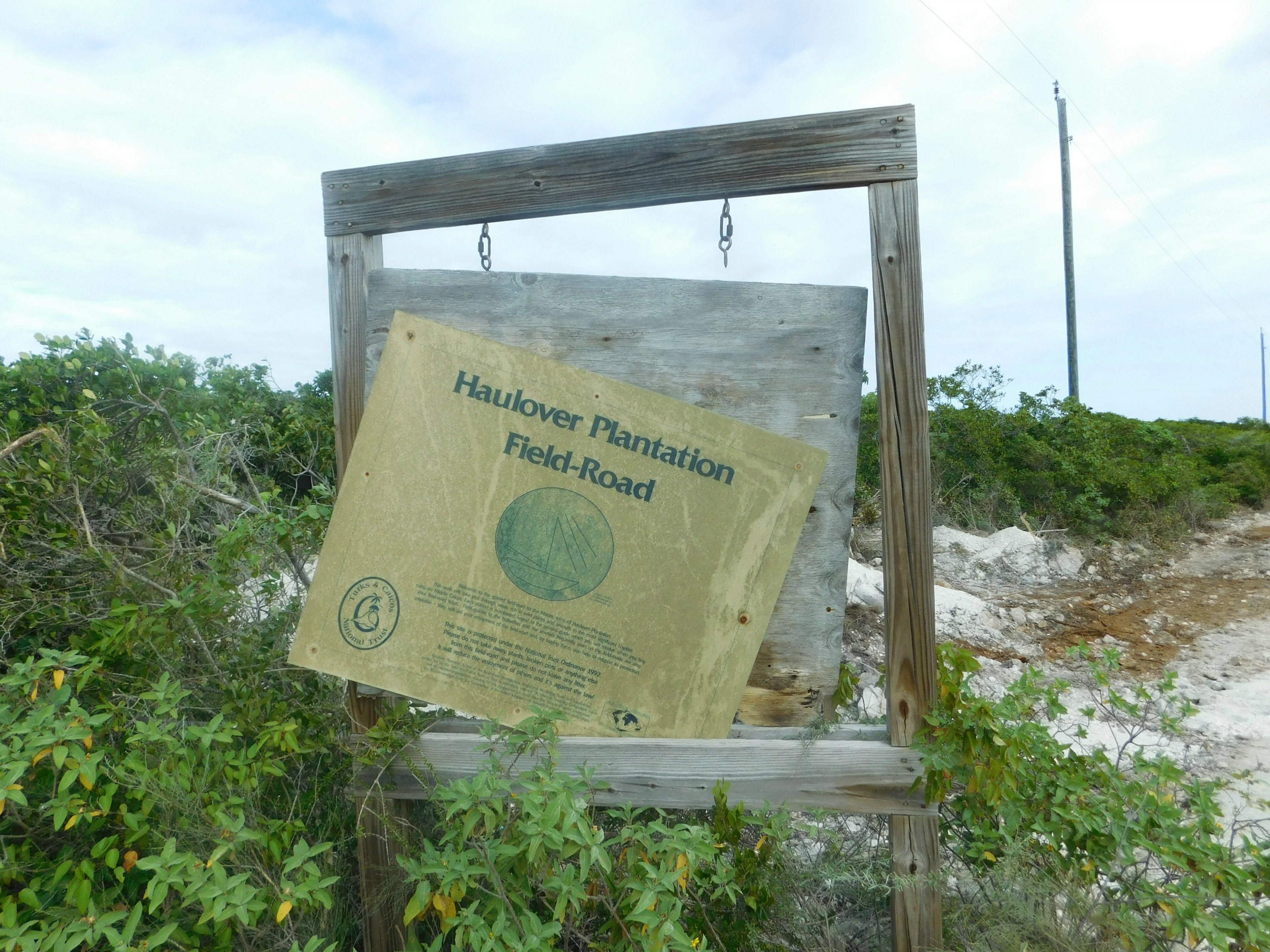Sign for Haulover Plantation in Middle Caicos - Turks & Caicos Island Guide - DIY Daytrip to North and Middle Caicos